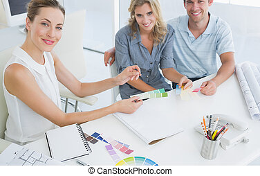 Group of artists working on designs