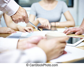 group of asian business people meeting in office
