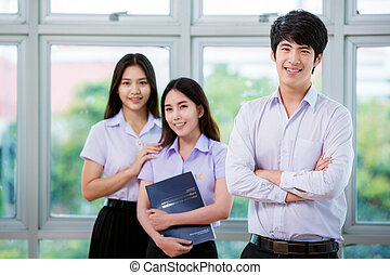 Group of Asian student in Thai university sit and relax in...