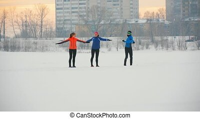 Group of athletes doing the exercise in winter ice field