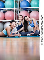 Group of athletic women have a rest