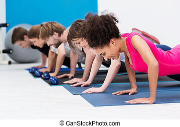 Group of athletic young people in a gym