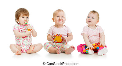 group of babies with musical toys