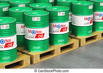 Group of barrels with motor oil lubricant on shipping pallets in warehouse