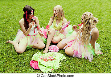 group of beautiful female friends smiling.  three pretty  girls