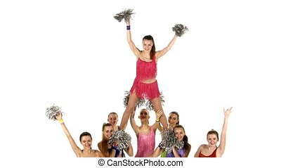 Group of beautiful girls dancing. Cheerleading. gymnastic stunt. Close up