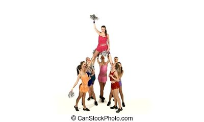 Group of beautiful girls dancing. Cheerleading. gymnastic stunt