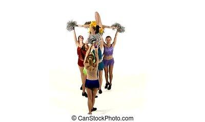 Group of beautiful girls dancing. Cheerleading. pompons, on...