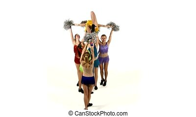 Group of beautiful girls dancing. Cheerleading. pompons