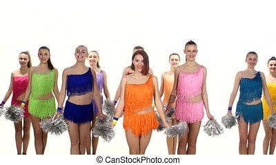 Group of beautiful girls jumping with pom-poms in hand....