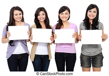 Group of beautiful women with blank paper