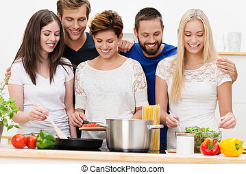 Group of beautiful young women cooking