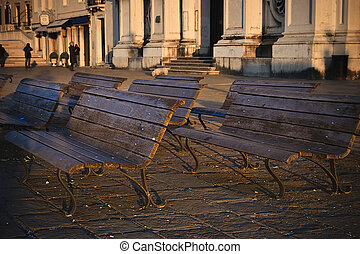 benches - Group of benches in the morrning sun light at...