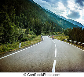 Group of bikers on mountainous road
