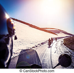 Group of bikers on snowy road