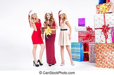 Group of blondies with Christmas gifts