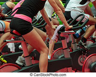 Group of Boys and Girls at Gym: Workout with Spinning Bikes