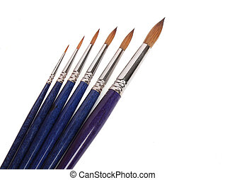 Group of brushes over white