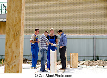 Group of builders having a meeting