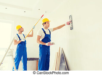 group of builders with tools indoors - business, building, ...