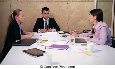 Group of business partners sharing ideas at office -...