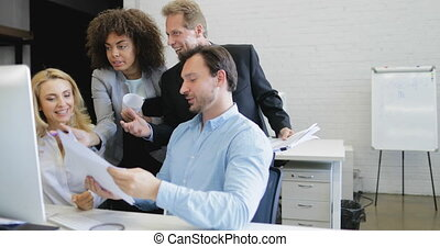 Group Of Business People Analyzing Documents Point Finger On Computer Motinor, Businesspeople Team Working Process In Modern Coworking Space Slow Motion 60