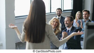 Group Of Business People Applauding Congradulating Businesswoman With Successful Presentation At Conference Meeting In Office