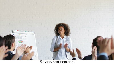 Group Of Business People Applauding Congradulating Happy African American Businesswoman With Successful Speech During Conference Meeting