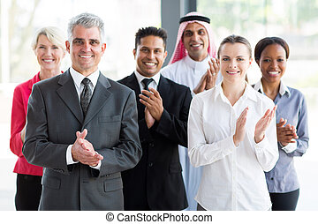 group of business people applauding - group of cheerful...