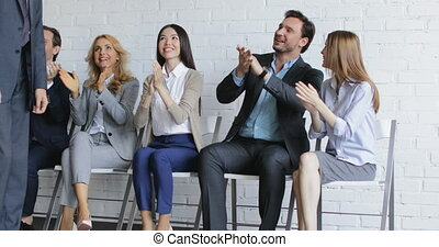 Group Of Business People Applauding Speaker Walking In Conference Hall On Meeting, Colleagues Team Greeting Leader Clapping Hands Happy Smiling Before Presentation In Office