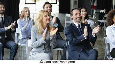 Group Of Business People Applauding Congradulating...