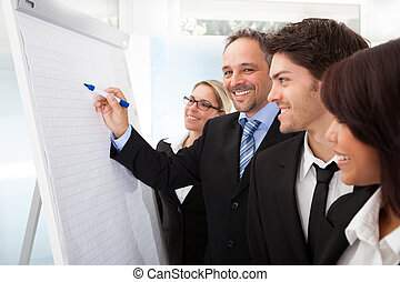 Group of business people at presentation - Group of business...