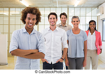 Group of business people being cheerful and smiling at...