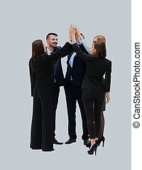 Group of business people celebrating their teamwork with a high five.