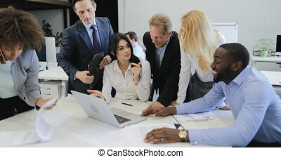 Group Of Business People Cheering For Good Results Clappping Hands During Meeting In Office, Successful Team Discussing Reports
