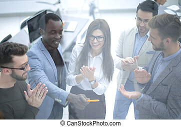 Group of business people clapping hands.