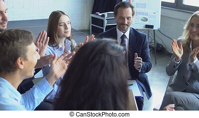 Group Of Business People Clapping Hands Finishing Successful...