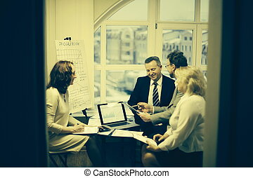group of business people discussing an important document.