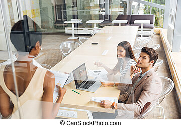 Group of business people discussing new ideas in conference hall