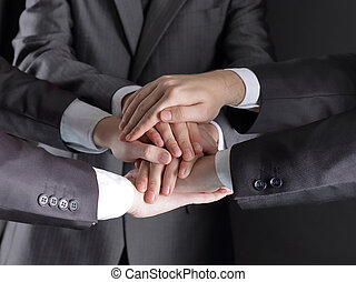 group of business people folded their hands together