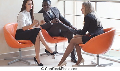 Group of business people having a meeting in an informal setting.