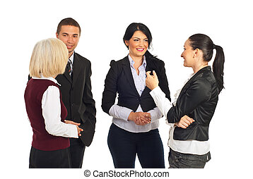 Group of business people having conversations over white ...