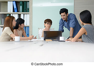 Group of business people having different age in creative business discussing work in the office