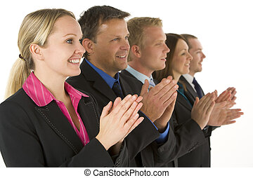 Group Of Business People In A Line Smiling And Applauding