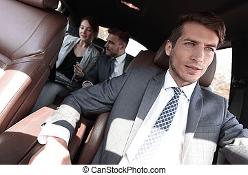 group of business people in a luxury car