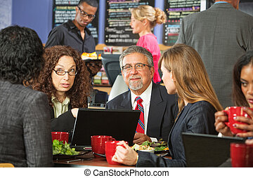 Group of Business People in Cafe