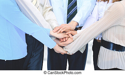 group of business people in the office have combined hands together.