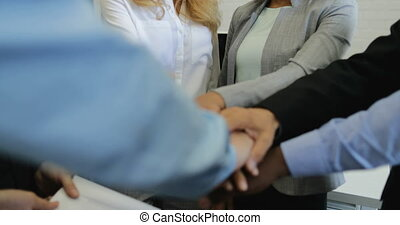 Group Of Business People Join Hands Together In Creative...
