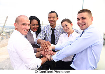 Group of Business People Join the Hand or United