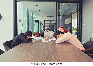 Group of business people sleeping in a meeting room, Multi ethnic